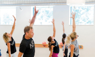 A group of people train at  Edina's new Barre3 studio