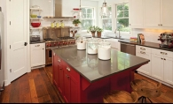 Red kitchen accents are among the many stylish design elements of this urban farmhouse by Refined, LLC.