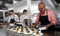 Andrew Zimmern prepares food for Taste Fore the Tour