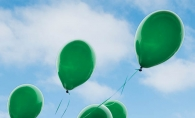 Green balloons from Jerry's Foods honor a young boy's Irish heritage after his passing.