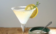 Lemon Drop martini with rosemary simple syrup and garnish.