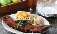 Rack it up with a platter of baby back ribs and a game of bocce ball at Pinstripes.