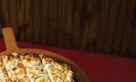 Perfect for snacking or a summer supper, Red's Savoy serves up a variety of delicious pizza pies.
