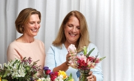 Karen Wooldridge and Laura Hogan of Bluebirds & Blooms prepare a bouquet.
