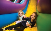 Kids play on an inflatable slide at Southdale Center's Bounce Town