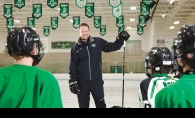 Edina AA Bantam youth hockey coach Ryan Ebling speaks to his team.