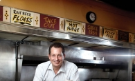 Tony Rimarcik, son of Convention Grill owner John Rimarcik, serves up the diner's most popular meal: cheeseburger, fries and a malted milk.