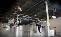 Chad Zwadlo, Mitch Andrejka,  Colin Cooper and Josh Carlson demonstrate advanced parkour techniques at Fight or Flight Academy in Edina.