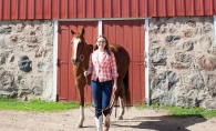 Edina artist Claire Jensen with her muse, a horse named Mama.