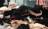 A table of donated bras and underwear for La Bratique's bra drive.