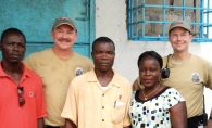 James Harding, left, and Tom Schmitz, right, with LNFS trainers in Liberia.