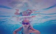 "A girl swims underwater at the Edina Pool in Melissa Hunzelman's photograph ""Little Fish"""