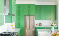 A kitchen renovation by City Homes, featuring quartz countertops and green cabinets.