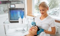 A woman receives a hydrafacial to combat sun damage.