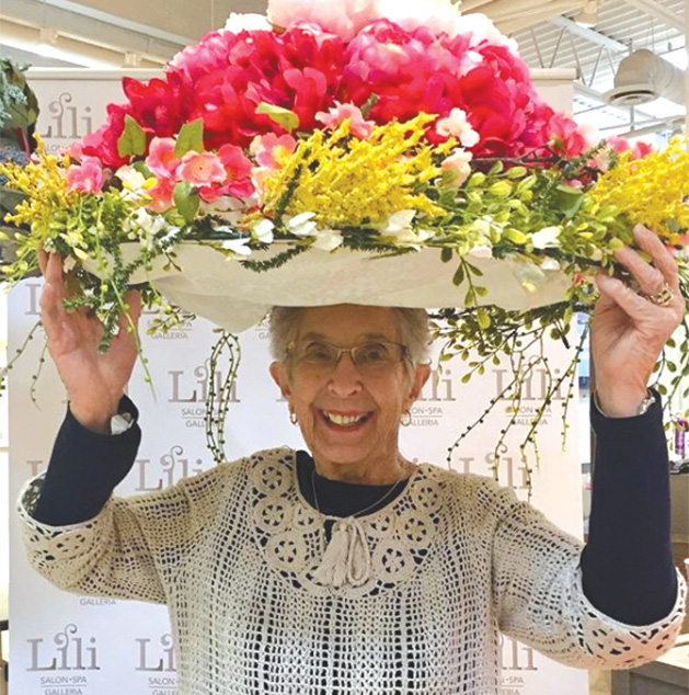 @cindyminnesota models a flower hat at the Galleria Garden Party
