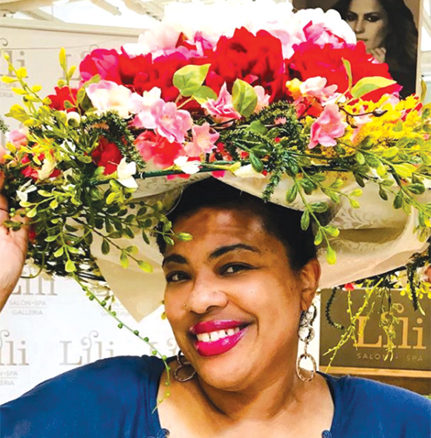 Minneapolis blogger Stacie Raye models a flower hat at the Galleria Garden Party.