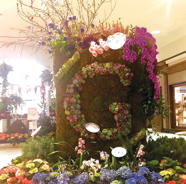 """A """"G"""" made of flowers at the Galleria Garden Party"""