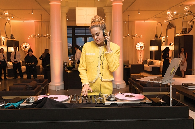 The DJ performs at the Restoration Hardware Edina grand opening