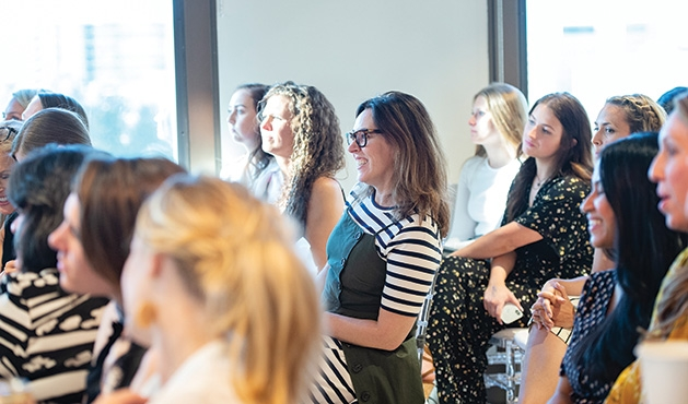 Guests listen to a speaker at the Evereve Minneapolis Influencer Social