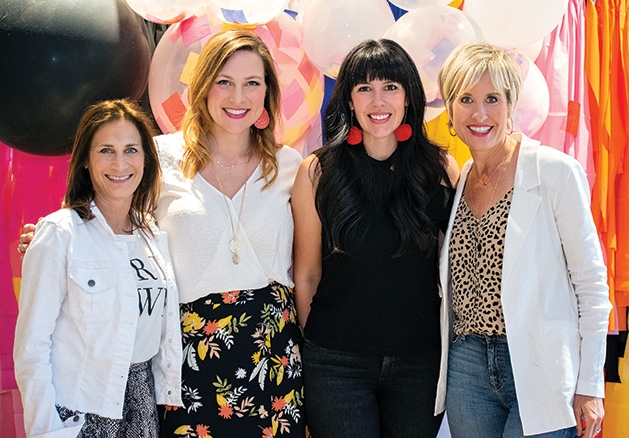 HGTV's Heather Fox, Evereve founder Megan Tamte and two other influencers pose for a photo at the Evereve Minneapolis Influencer Social.