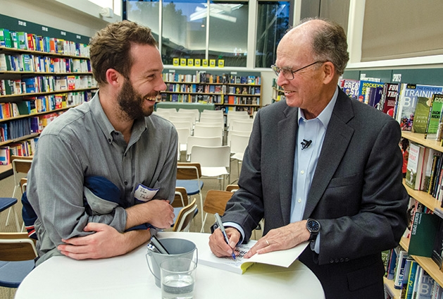 J. Allen speaks to Dan Dunlevy at his book signing.