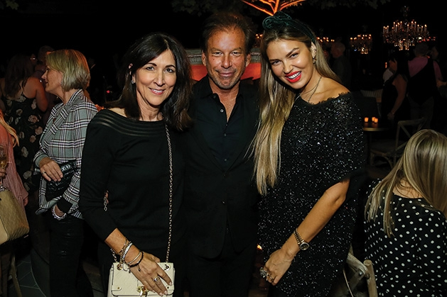Three people pose for a photo at the Restoration Hardware grand opening.