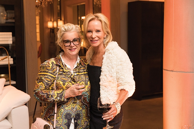 Two guests pose for a photo at the Restoration Hardware Edina grand opening.