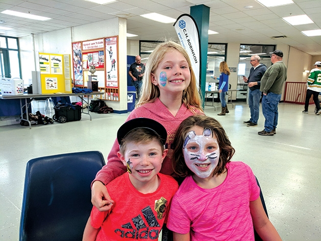 Three children with painted face at the 2019 Big Futures Tournament and Family Festival.