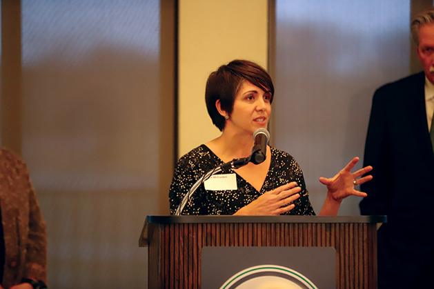 A volunteer speaks at the recognition reception.