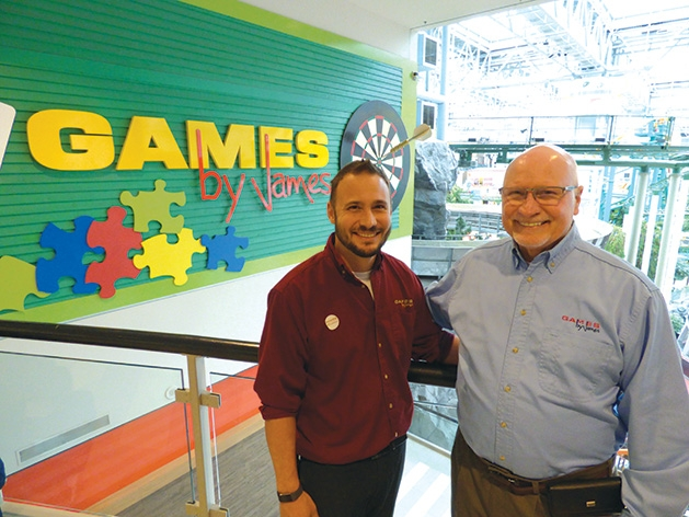 Owner Logan McKee and his father Glenn McKee at Games by James' 40th anniversary celebration