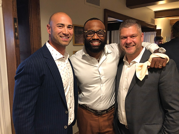 Ben Leber, Everson Griffen and another man at Taste Fore the Tour