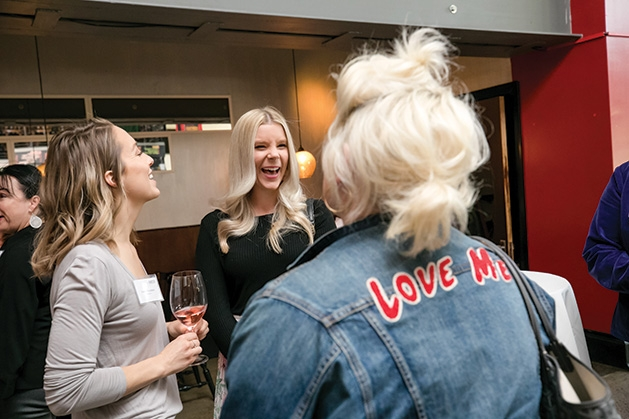 Attendees mingle at the grand opening of The Riveter co-working space in Edina.