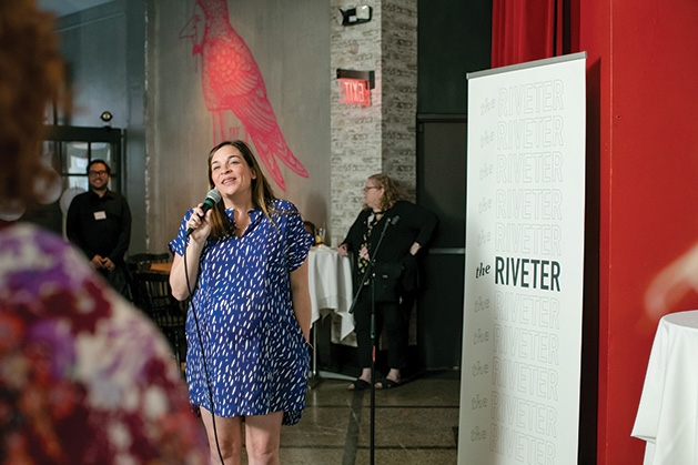 A woman speaks at the grand opening of The Riveter co-working space in Edina.