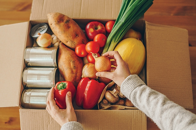 A box packed with food from VEAP Food Shelf