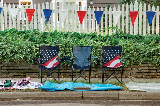 Empty chairs sit on 50th Street in anticipation of Edina's Fourth of July parade.