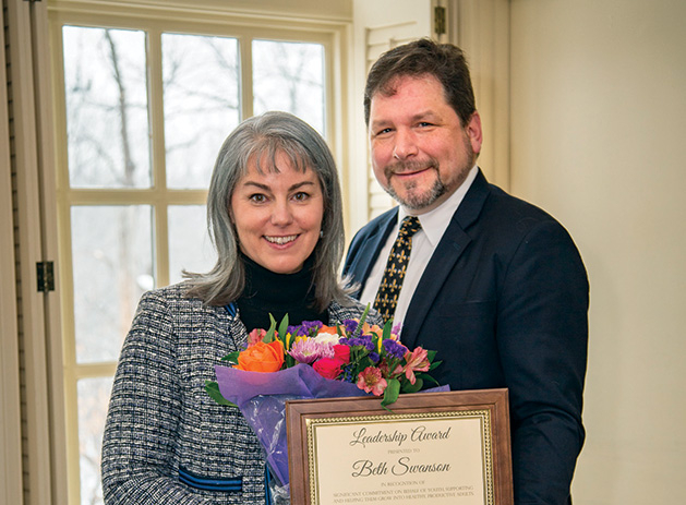 Beth Swanson, pictured with her husband James, was presented with a Connecting with Kids Leadership Award by the Edina Community Foundation