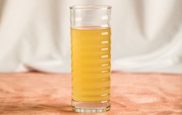 Chicken broth in a glass