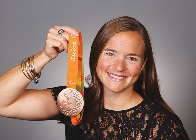U.S. veteran and Paralympian Melissa Stockwell holding medal