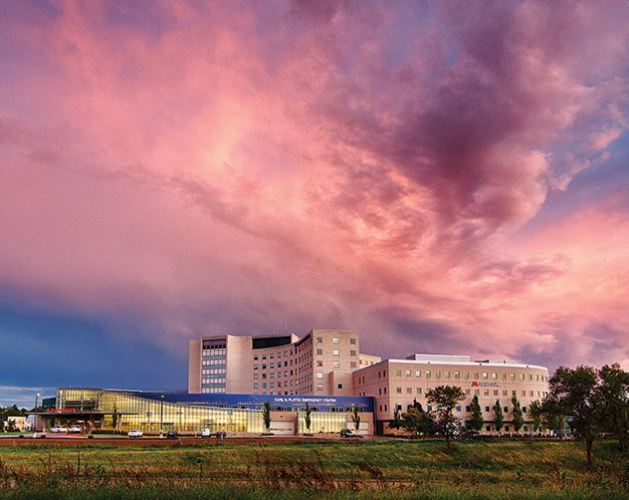 A pink sky after a storm hangs over the Fairview Southdale Hospital.
