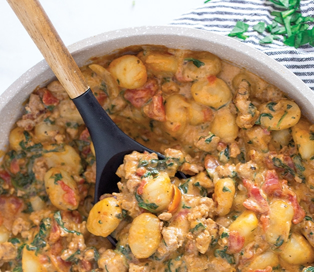Creamy sausage and spinach gnocchi, a one skillet recipe from Greens N Chocolate.