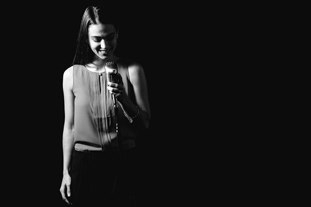 A black and white photo of a performer at HEREandTHERE.live, a new nonprofit performing arts venue at Southdale Center.