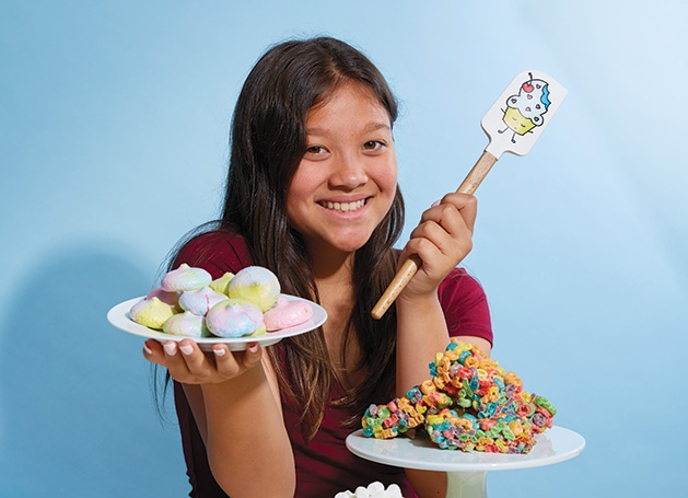 Kids Baking Championship contestant Meadow Roberts, founder of Sweet Meadow, holds some of her creations.