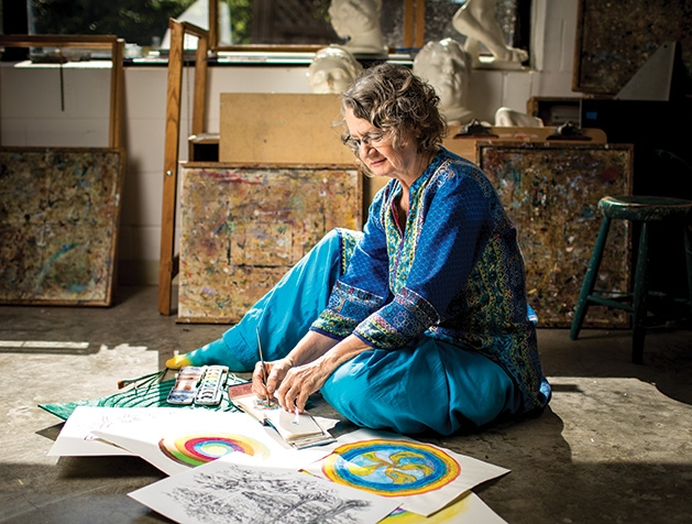 Meditative artist Holly Stone, who teaches classes at the Edina Art Center, works on a painting.