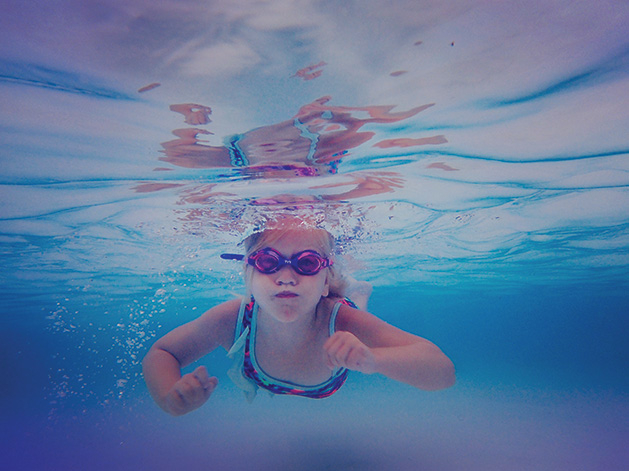 """A girl swims underwater at the Edina Pool in Melissa Hunzelman's photograph """"Little Fish"""""""