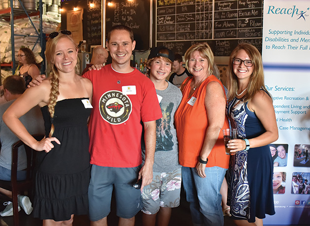Attendees of Reach for Resources' yearly fundraiser, Reach On Tap, pose for a photo at Wooden Hill Brewing Company.