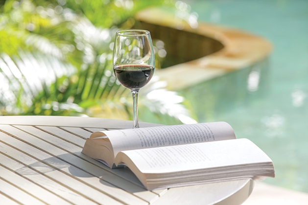 drinking wine while reading on patio
