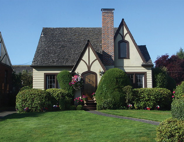 A newly remodeled home with a manicured lawn.