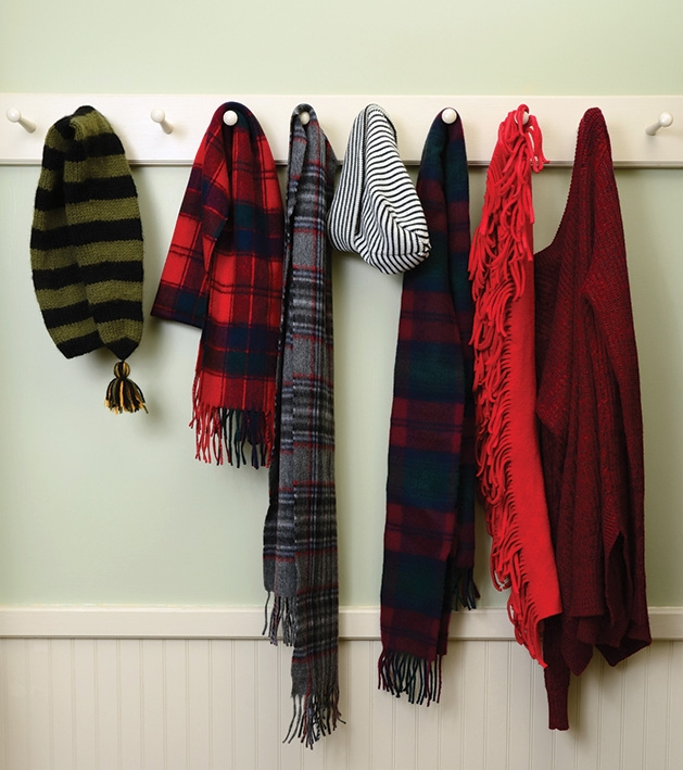 Winter gear like hats and scarves hang on hooks.