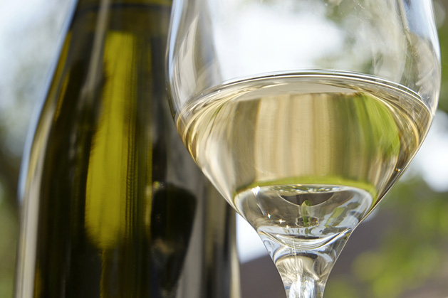 A bottle and glass of Riesling white wine