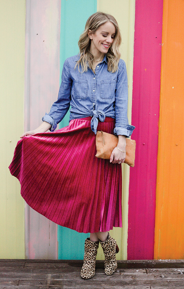 A fashion model wears animal print boots, a pink skirt and a chambray shirt